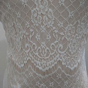 Beautiful lacy evening dress, never been worn!